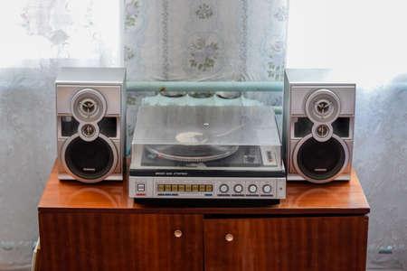 Krasnodar, Russia - March 31, 2020: Vintage soviet electrophone Vega 109 stereo. Turntable vinyl, old equipment. Редакционное