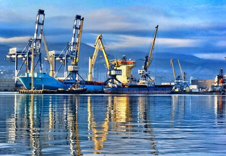 Port cranes in the port of Novorossiysk. Industrial port landscape. Фото со стока