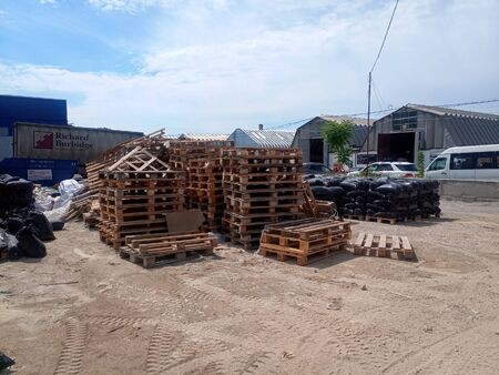 Packages with rubble and sand on the construction site. Building materials base. Фото со стока