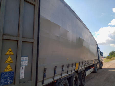 Taman, Russia - June 9, 2019: cargo displacement inside the truck. The gas block moved off the pallet. Damage to the cargo.