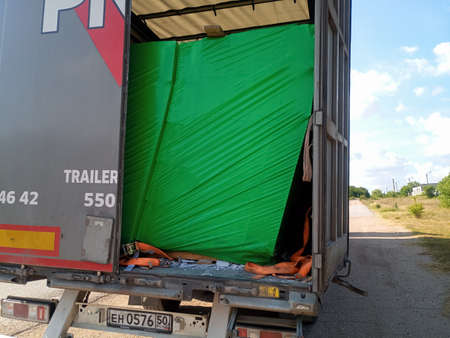 Taman, Russia - June 9, 2019: cargo displacement inside the truck. The gas block moved off the pallet. Damage to the cargo. Editorial