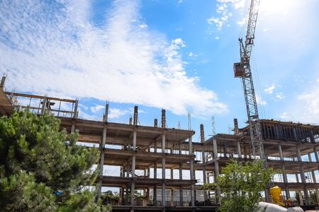 construction of multi-storey residential buildings. Tower cranes at a construction site.