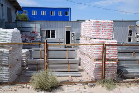Taman, Russia - June 9, 2019: Warehouse of building materials. a Building base, metal, wood and blocks with bricks.