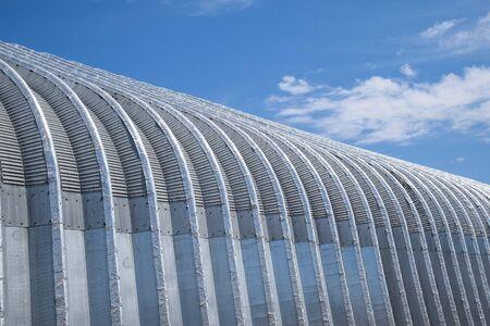 corrugated galvanized iron hangar. a Construction base.
