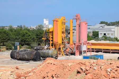 The factory is a whee. Mixing concrete for mixers. Concrete production. 免版税图像