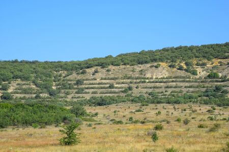 Landscapes of Crimean nature. Fields and hills visible from car window from the road. 스톡 콘텐츠