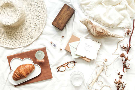 Trendy and stylish flat lay with woman accessories, hat, glasses, letters and croissant. Lifestyle and blogg concept. Фото со стока