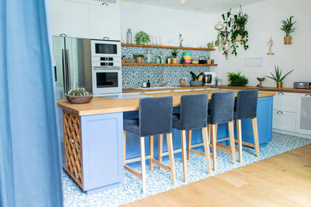 Fresh summer breakfast in Mediterranean style kitchen. Bright and sunny space with a lot of herbs and plants. Standard-Bild