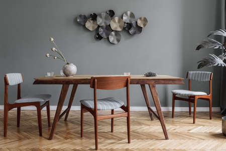 Modern dining room interior with glamor wooden table, stylish chairs and design decoration. Template. Home decor.