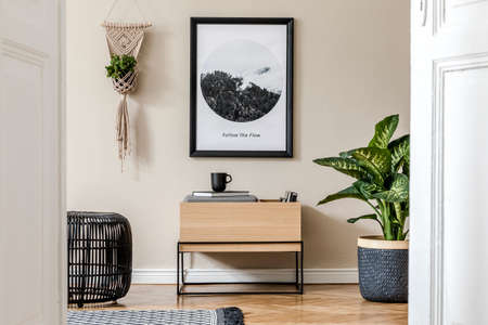 Scandinavian and design home interior of living room with wooden commode, design pouf, rattan basket with plants and elegant accessories. Stylish home decor. Template. Mock up poster paintings.