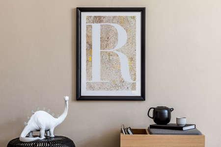 Modern scandinavian living room interior with black mock up poster frame, design commode, dino lamp, black rattan basket, teapot, books and elegant accessories. Template. Imagens