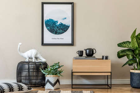 Scandinavian and design home interior of living room with wooden commode, design table lamp, rattan basket with plants and elegant accessories. Stylish home decor. Template. Mock up poster paintings