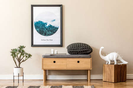 Design scandinavian home interior of living room with wooden commode, design table lamp, rattan basket with plants and elegant accessories. Stylish home decor. Template. Mock up poster frame.
