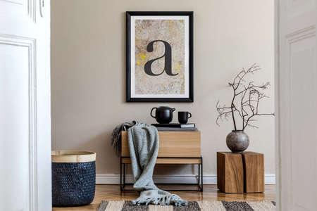 Modern scandinavian living room interior with black mock up poster frame, design commode, dried flower in vase, black rattan basket, books and elegant accessories. Template. Imagens