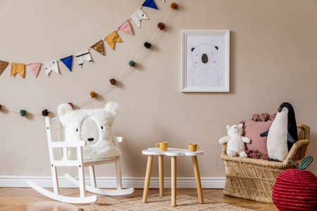 Stylish scandinavian kid room with mock up poster, toys, teddy bear, plush animal, natural pouf and children accessories. Modern interior with beige background walls. Template. Design home staging. Banque d'images