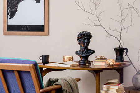 Stylish composition of elegant personal accessories at private library interior with bookstand and vintage table. Retro home decor. Candles, photo camera and a lot of books. Template. Close up. Zdjęcie Seryjne