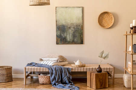 Modern composition of living room with design chaise longue, mock up painting, rattan decoration, wooden cube, carpet and elegant personal accessories. Stylish oriental concpet of home decor.