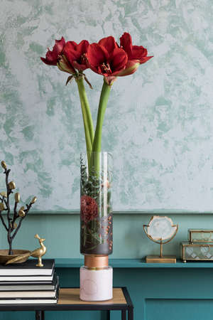 Stylish and floral composition of beautiful flowers in modern vase on the bookstand with elegant accessories and furnitures. Blossom concept at living room. Green walls. Interior design. Template. Zdjęcie Seryjne
