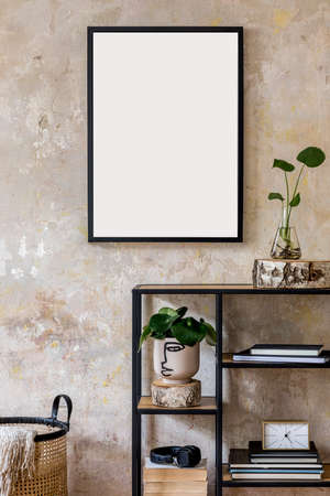 Modern composition of living room interior with black mock up poster frame, bookstand, plants and accessories. Stylish home decor. Grunge wall. Wabi sabi. Template. Zdjęcie Seryjne
