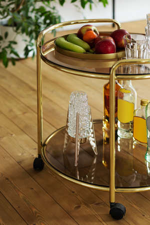Modern composition of gold kitchen bar with different drinks, fruits, decoration and elegant personal accessories. Template. Reklamní fotografie
