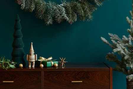 Christmas composition with decoration, christmas tree, gifts and accessories in cozy home decor. Copy space. Template.