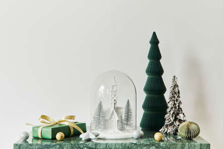 Christmas composition with beautiful decoration, christmas tree and wreath, deer, gifts and accessories in modern home decor. Template.