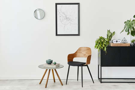 Modern retro concept of home interior with design chair, coffee table, plants, mock up poster map, carpet and personal accessoreis. Stylish home decor of living room. 版權商用圖片