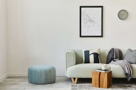 Stylish loft interior with green sofa, design pouf, mock up poster map, furniture, carpet, plants, decoration and elegant accessories. Modern home decor. Template.