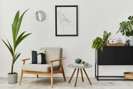 Modern retro concept of home interior with design gray armchair, coffee table, plants, mock up poster map, carpet and personal accessories. Stylish home decor of living room. 版權商用圖片