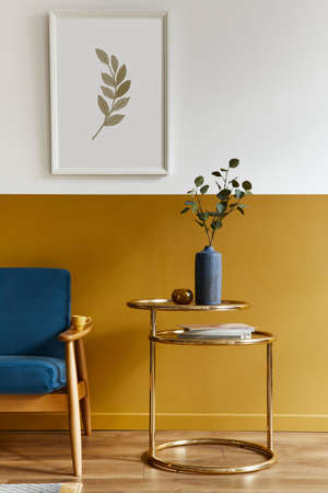 Unique living room in modern style interior with design sofa, elegant gold coffee table, mock up poster frames, flowers in vase, decoration and pesronal accessories in home decor. Template. 版權商用圖片