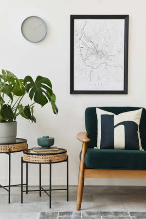Modern retro concept of home interior with design green sofa, coffee tables, plants, mock up poster map, carpet and personal accessoreis. Stylish home decor of living room. 版權商用圖片