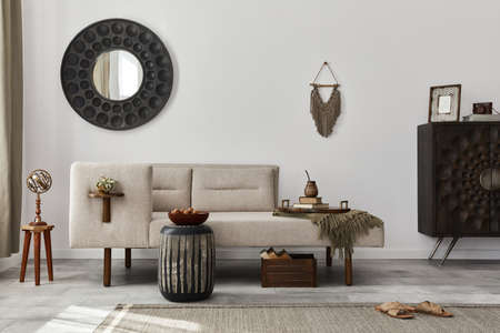 Modern ethnic living room interior with design chaise lounge, round mirror, furniture, carpet, decoration, stool and elegant personal accessories. Template. Stylish home decor. 版權商用圖片 - 160681795