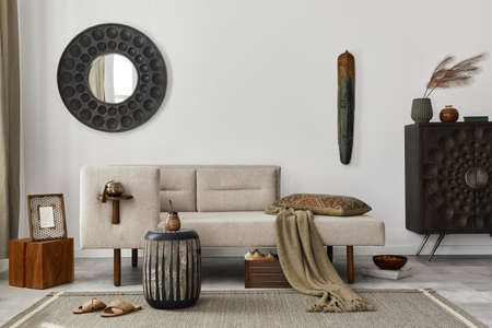 Modern ethnic living room interior with design chaise lounge, round mirror, furniture, carpet, decoration, stool and elegant personal accessories. Template. Stylish home decor. 版權商用圖片 - 160681813