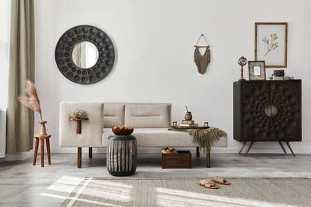 Modern ethnic living room interior with design chaise lounge, round mirror, furniture, carpet, decoration, stool and elegant personal accessories. Template. Stylish home decor. 版權商用圖片 - 160681814