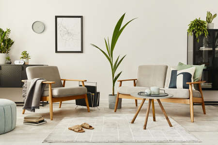 Modern retro concept of home interior with design sofa, armchair, coffee table, plants, mock up poster map, carpet and personal accessoreis. Stylish home decor of living room. 版權商用圖片 - 160551194