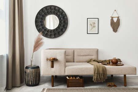 Modern ethnic living room interior with design chaise lounge, round mirror, furniture, carpet, decoration, stool and elegant personal accessories. Template. Stylish home decor. 版權商用圖片 - 160681821