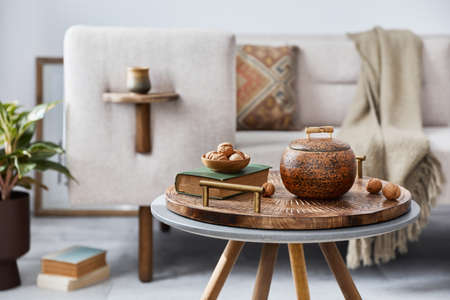 Elegant ethnic composition of living room interior with design coffee table, sofa, decoration, mock up frame and acceessories in modern home decor. Template. Details. 版權商用圖片 - 160681820