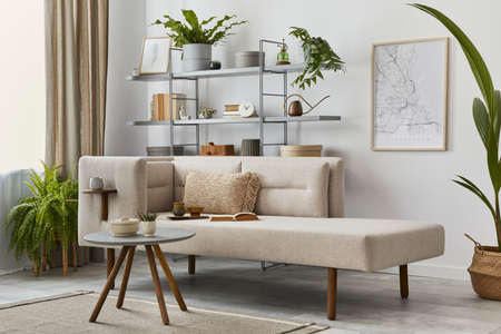 Cozy interior with stylish sofa, design coffee table, bookcase, plants, carpet, decoration, mock up poster map and elegant personal accessories. Neutral living room in classic house. Template.