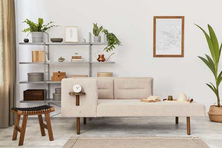 Cozy interior with stylish sofa, gray coffee table, bookcase, plants, carpet, decoration, mock up poster map and elegant personal accessories. Neutral living room in classic house. Template. 版權商用圖片