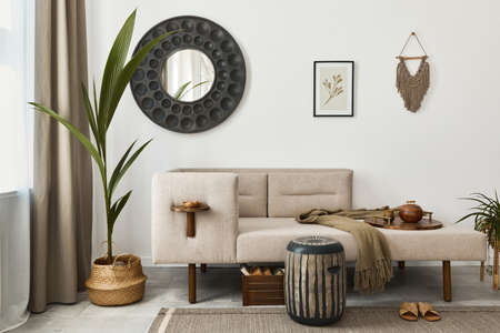 Modern ethnic living room interior with design chaise lounge, round mirror, furniture, carpet, decoration, stool and elegant personal accessories. Template. Stylish home decor. 版權商用圖片 - 160681826