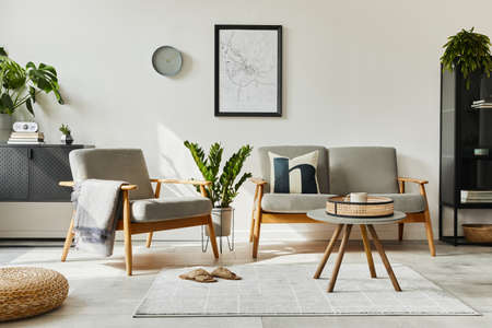 Modern retro concept of home interior with design sofa, armchair, coffee table, plants, mock up poster map, carpet and personal accessoreis. Stylish home decor of living room.