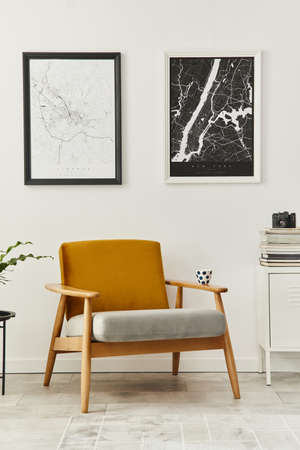 Retro and minimalist compositon of living room interior with design armchair, two mock up poster map, lamp, decoration, white wall and personal accessories. Template. Modern home decor. 版權商用圖片 - 160551196