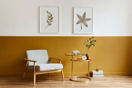 Unique living room in modern style interior with design armchair, elegant gold coffee table, mock up poster frames, flowers in vase, decoration and pesronal accessories in home decor. Template. 版權商用圖片 - 160681865