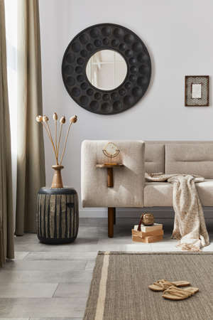 Interior design of ethnic style living room with modern commode, round mirror, decoration, furniture and personal accessories. Template. White wall. 版權商用圖片 - 160681869