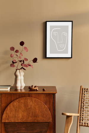 Interior design of unique living room with stylish commode, armchair, dired flowers in vase, mock up poster on the wall, decoration and personal accessories in modern home decor. Template.