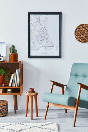 Retro composition of living room interior with mock up poster map, wooden shelf, book, stool, armchair, plant, cacti, vinyl recorder and personal accessories in stylish home decor. Stock fotó