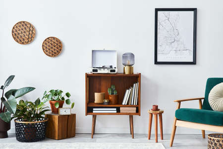 Stylish interior of living room with design wooden shelf, velvet sofa, a lot of plants, mock up poster map, vinyl recorder, book and personal accessories in vintage home decor. Template. Stock fotó
