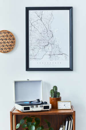 Stylish scandinavian living room interior with retro commode, black mock up poster frame, clock, cacti decoration, book and personal accessoreis in home decor. Template Stock fotó