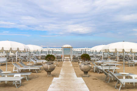 Empty beach with white sunshades against the sky, Italy, Riccione