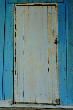 White door on blue wall photo